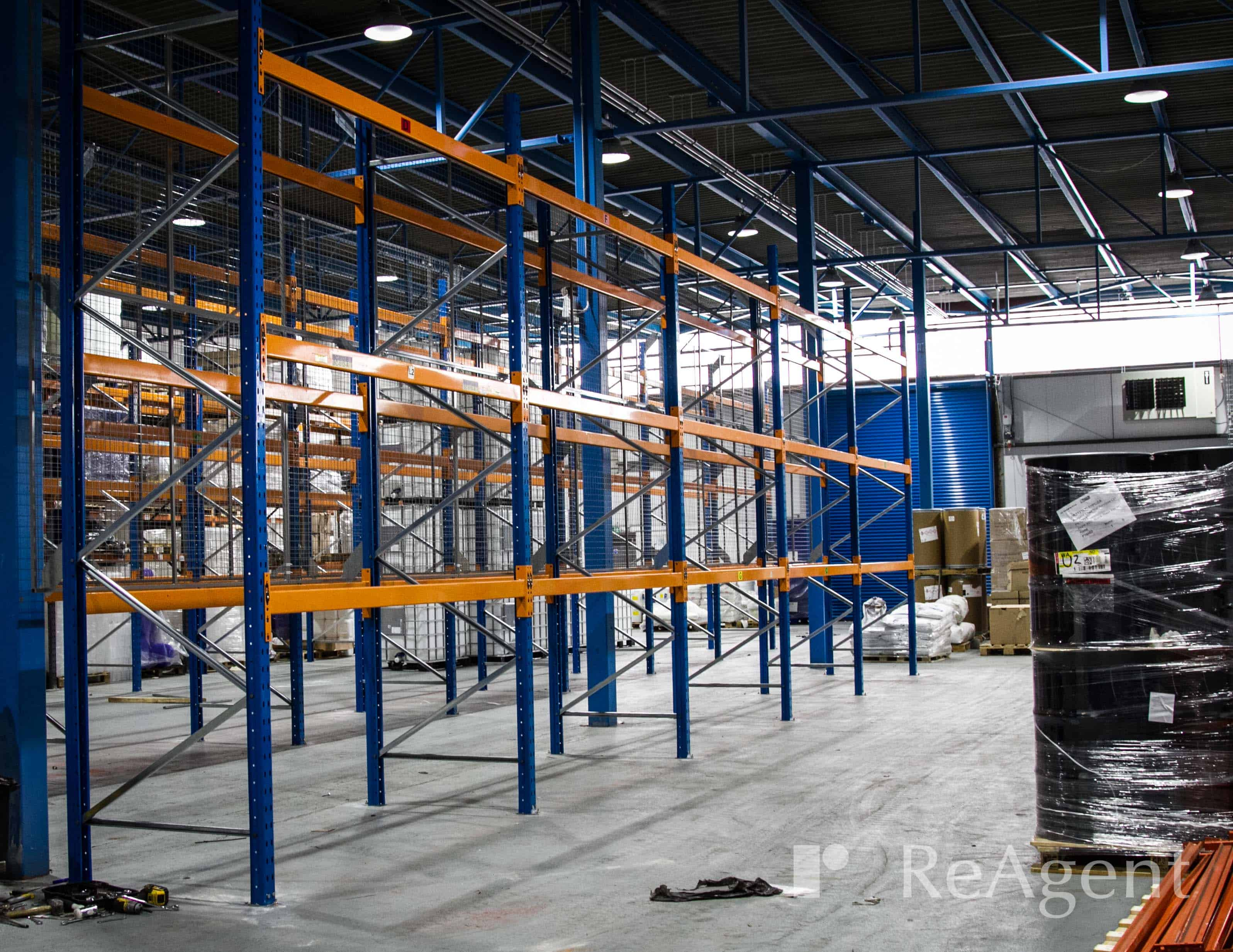 Empty wide-aisle pallet racking on ReAgent's factory floor
