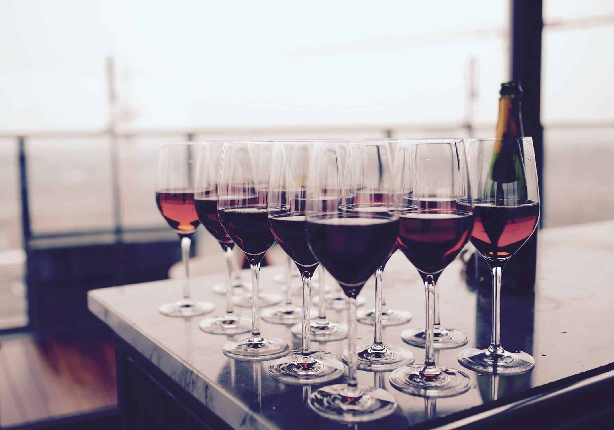 Glasses of red wine on a table