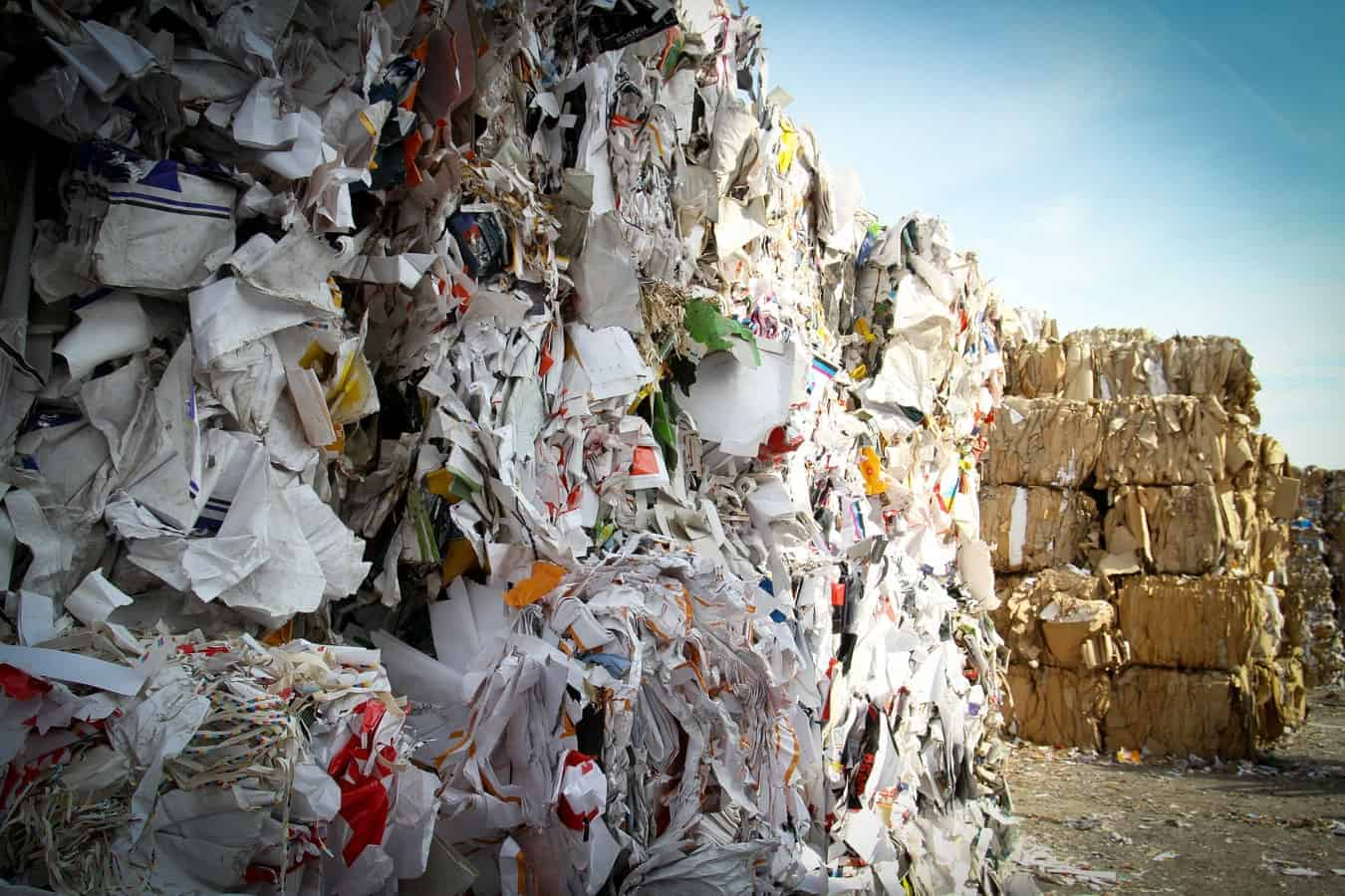 Paper garbage piles at landfills