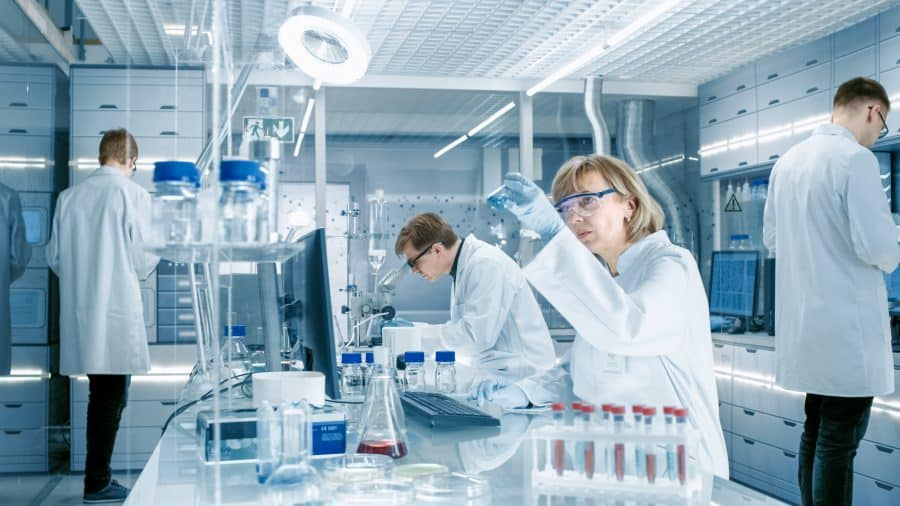 Analytical chemists in a lab analyzing samples