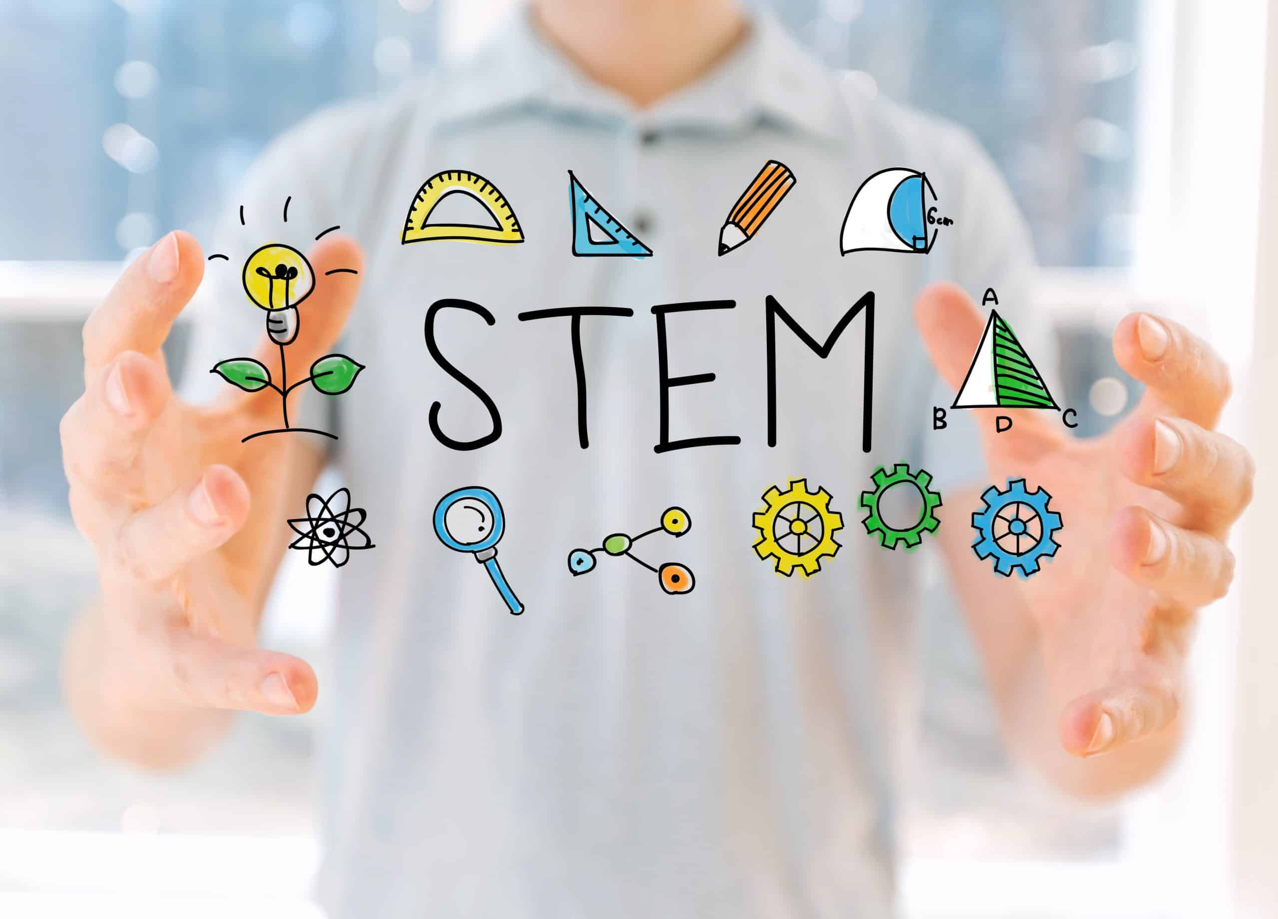 STEM with young man holding his hands