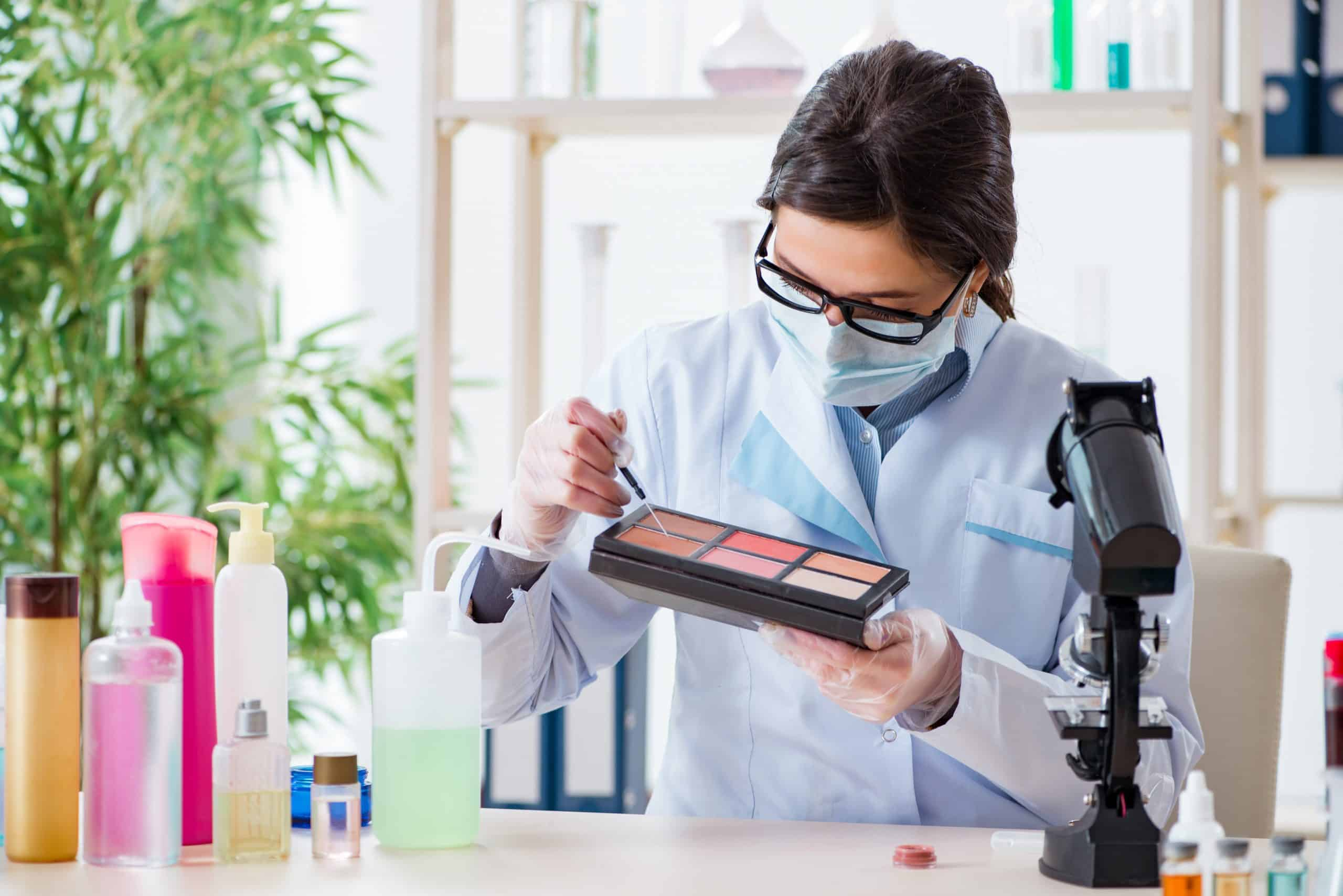 Cosmetic chemist checking beauty and make-up products